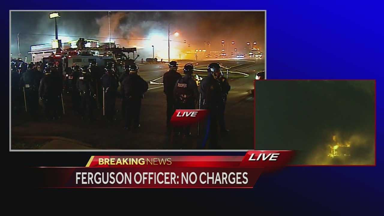 KMBC 9's Eli Rosenberg says he watched Ferguson police assemble and mobilize to take some sort of action as unrest continued in the city following the announcement that no charges will be filed against the officer who killed Michael Brown.