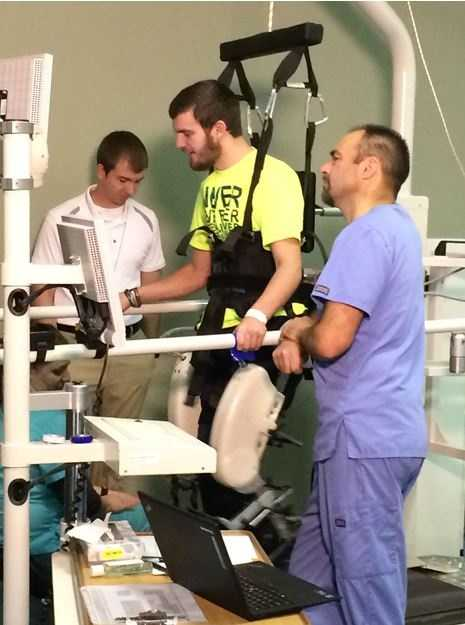 James McGinnis rehabs on a walking machine at the Madonna Rehabilitation Hospital in Nebraska. He suffered injuries in a football game earlier this year.