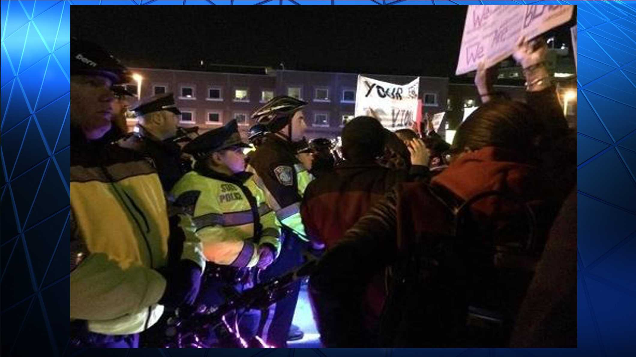 Protests continue nationwide in response to the grand jury decision in Ferguson, Missouri.  This photo shows one in the Boston area late Tuesday.