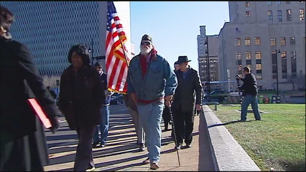 A group that marched peacefully through downtown Kansas City to protest the grand jury's decision not to indict Ferguson, Missouri, police Officer Darren Wilson said Tuesday's rally is only the beginning.