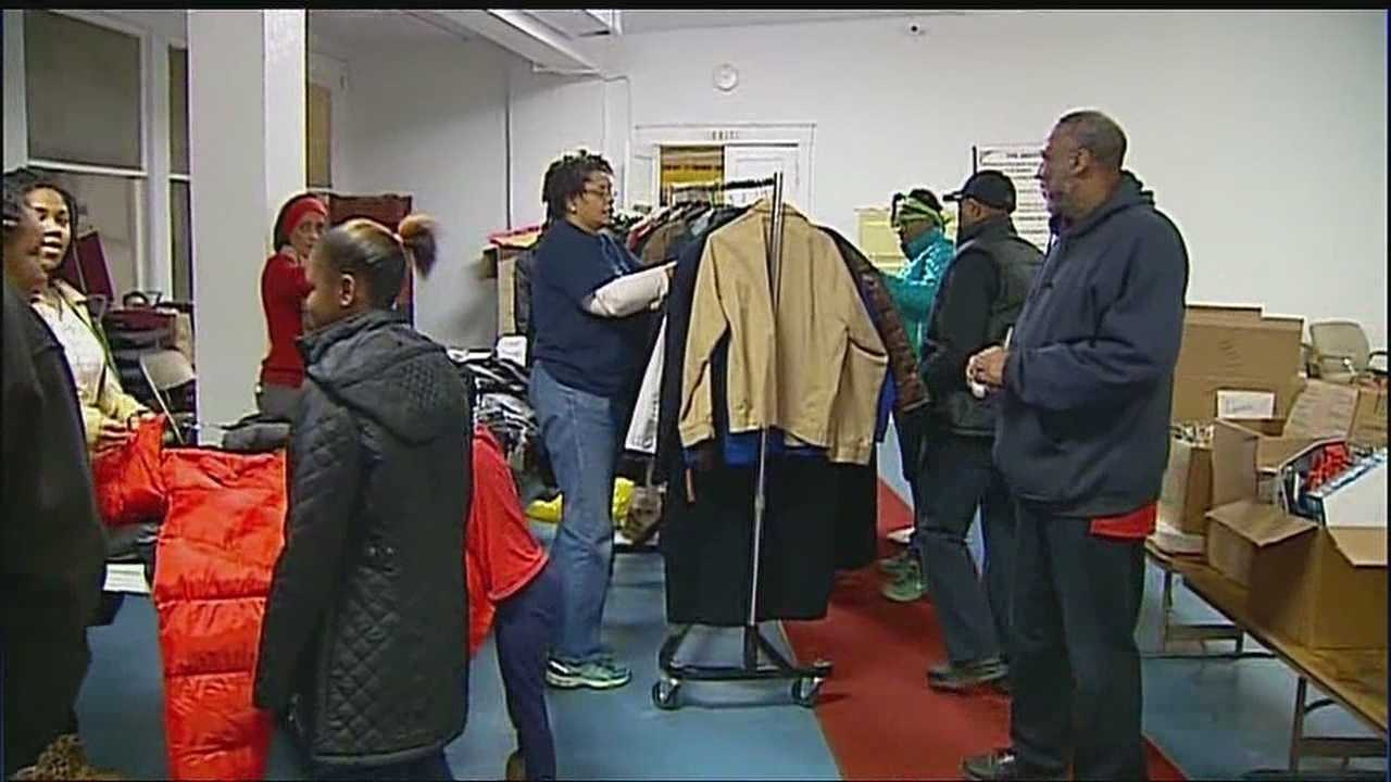 Volunteers at Morningstar Baptist Church organize clothing and toys to be given away for families in need this Christmas.