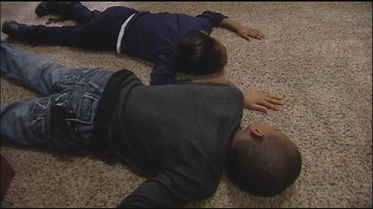 A KCK mother, concerned by a recent string of drive-by shootings, helps her children learn to recognize gunfire and duck down whenever they hear shots ring out in the neighborhood.