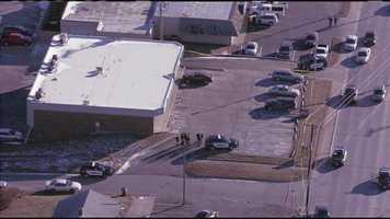 Several people were shot during a robbery at a Shawnee, Kan., gun shop on Friday afternoon. These are images from the scene.