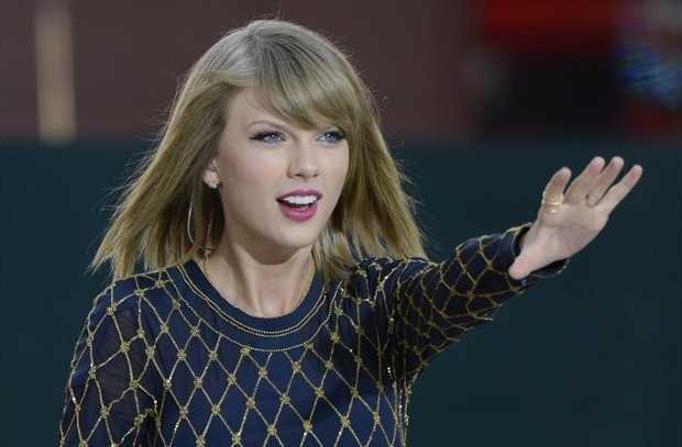 Singer Taylor Swift sends a package of presents to fan Rebekah Bortniker in Overland Park after she uploaded a video of the singer with her friends.