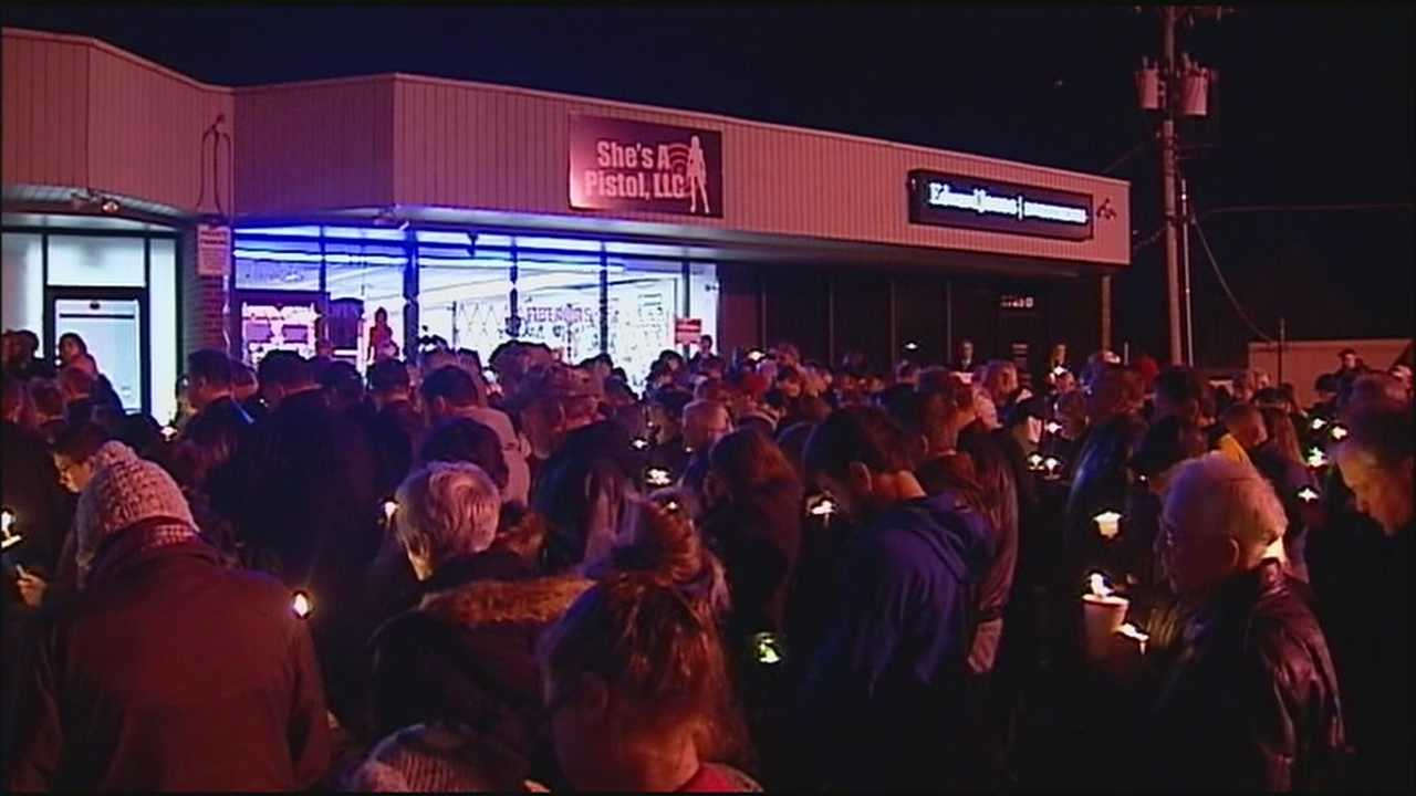 A large crowd came out to offer a show of support to a Shawnee business that was the scene of a botched robbery last week, leaving the store owner dead and his wife injured.