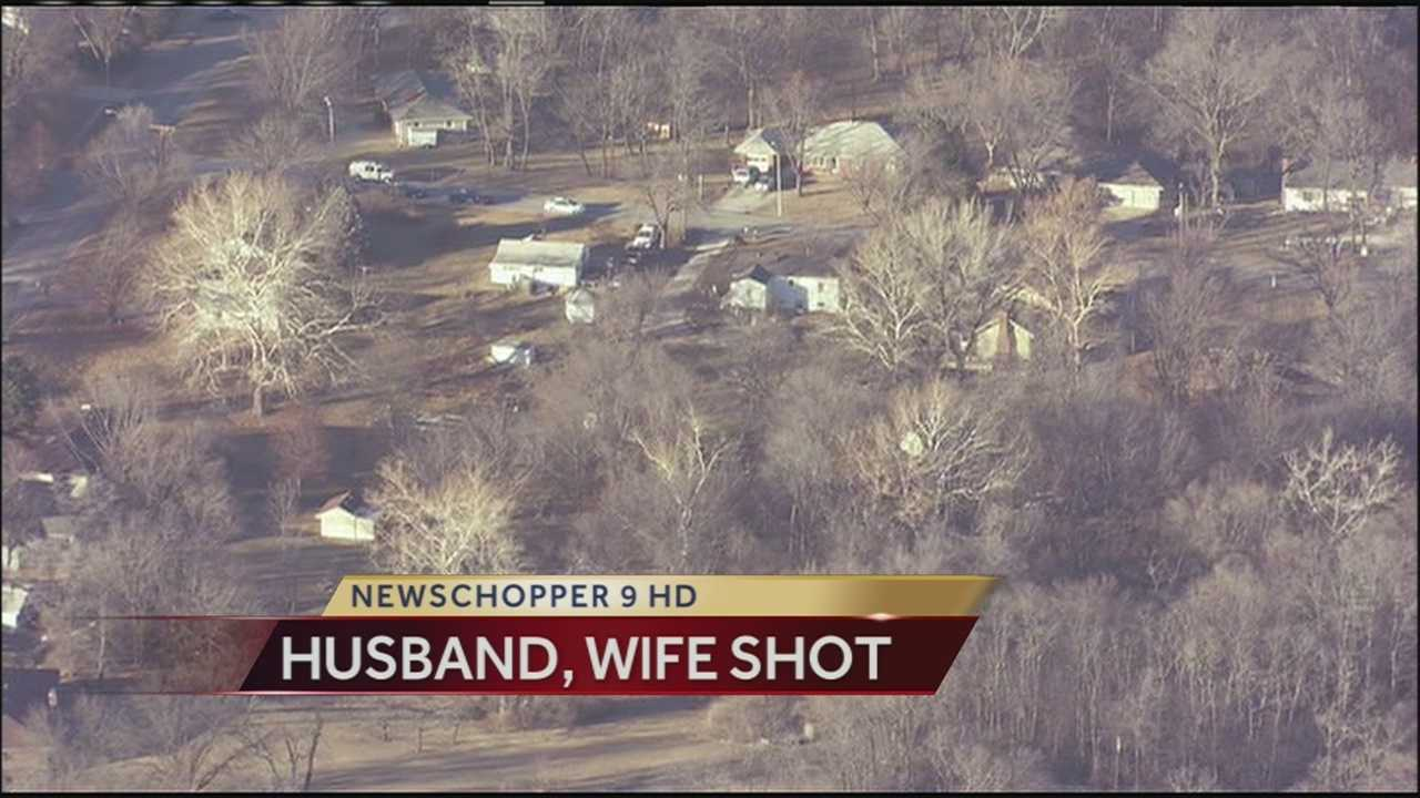 A husband is dead and his wife is in critical condition after they were shot by a gunman on Friday afternoon.
