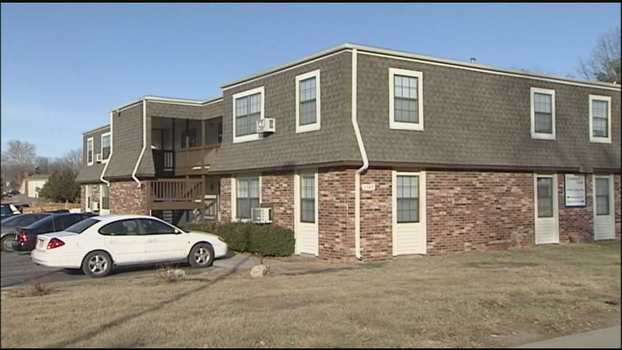 A 22-year-old woman was injured late Tuesday after someone fired shots into her apartment in Olathe.