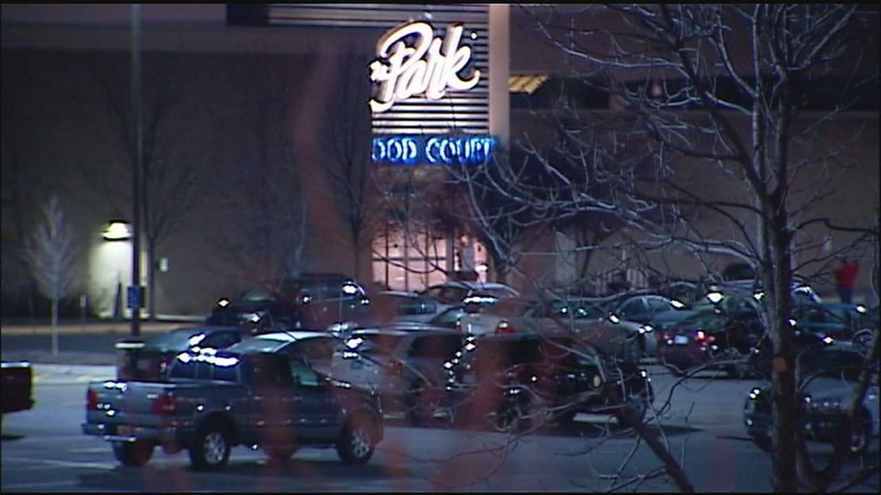 A woman said four people approached her in the parking lot at Oak Park Mall Wednesday and robbed her at gunpoint.