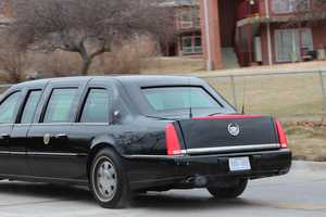 President Obama's motorcade drives down 19th Street in Lawrence.