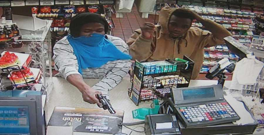 Kansas City police release surveillance images of three men suspected of robbing the FastStop convenience store on East 75th Street on Jan. 11.