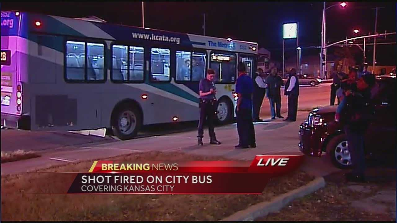 Police are looking for a man who ran off a city bus after his gun went off in southeast Kansas City.