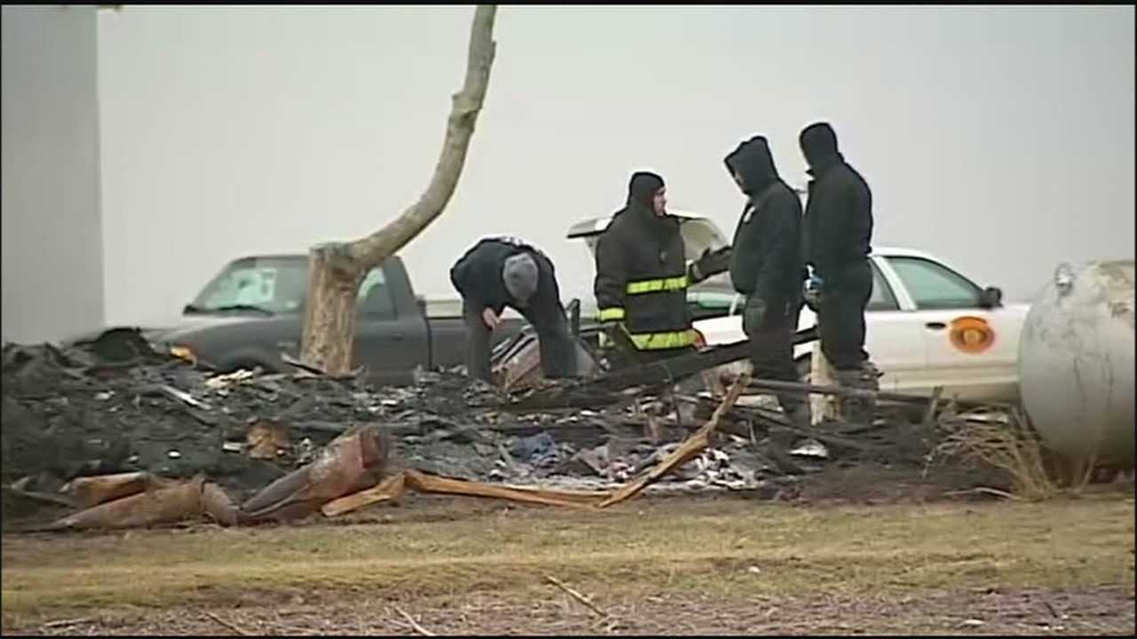 Search crews sift through the debris left behind from a house fire in northern Missouri, where three young children died.