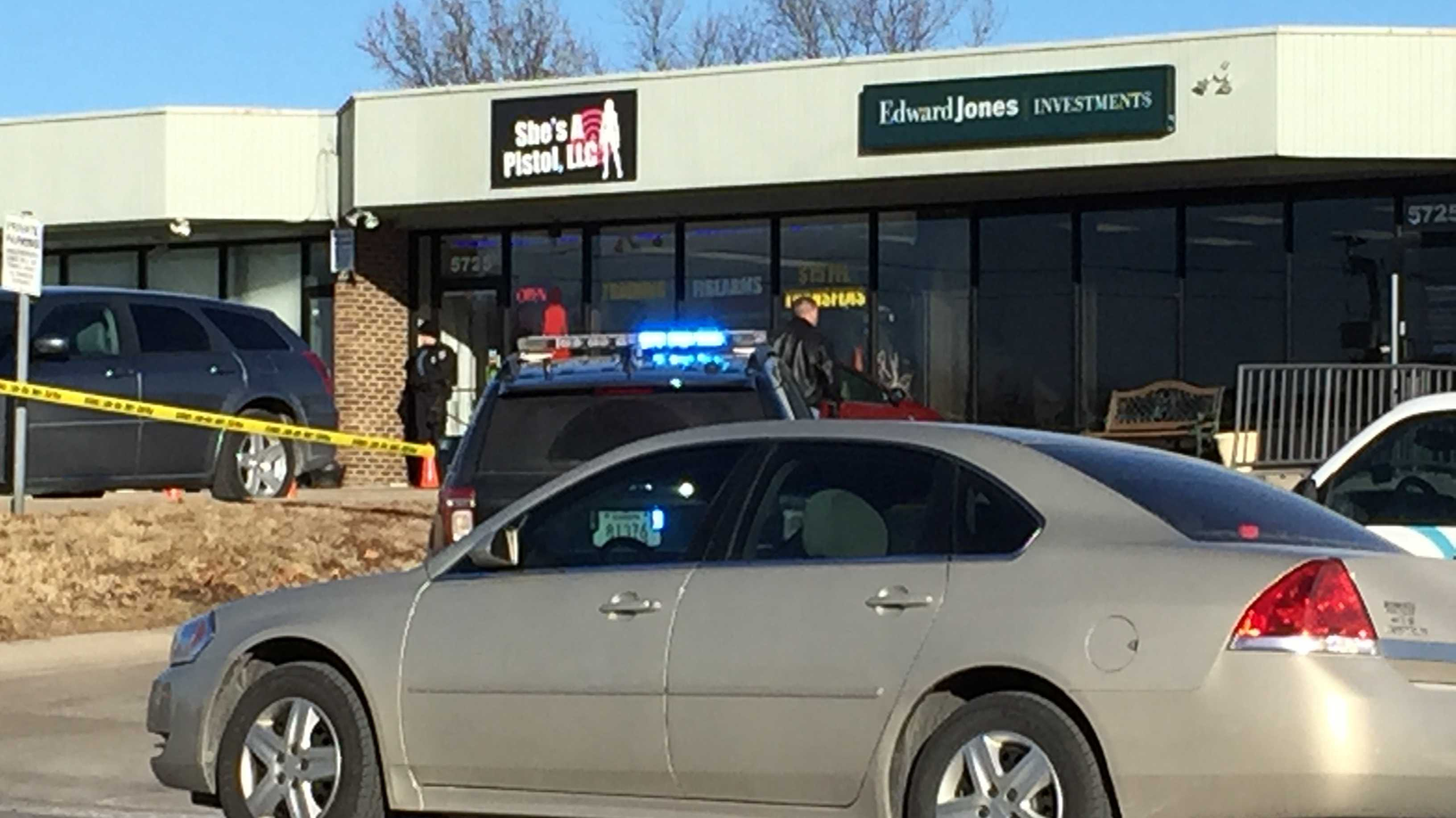 A Shawnee gun shop, where a co-owner died in what police call a botched robbery, will re-open.