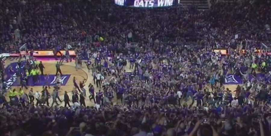 A wide view as fans rushed the court.