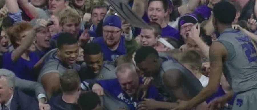 Wild fans surround Kansas State players following their win over KU.