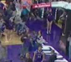 An enhanced view of a fan apparently running into a KU player.