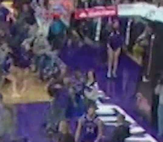 An enhanced view of a fan apparently running into a KU player.