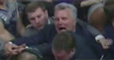 Kansas State Coach Bruce Weber attempts to shield University of Kansas Coach Bill Self as fans rushed the court on Monday night.