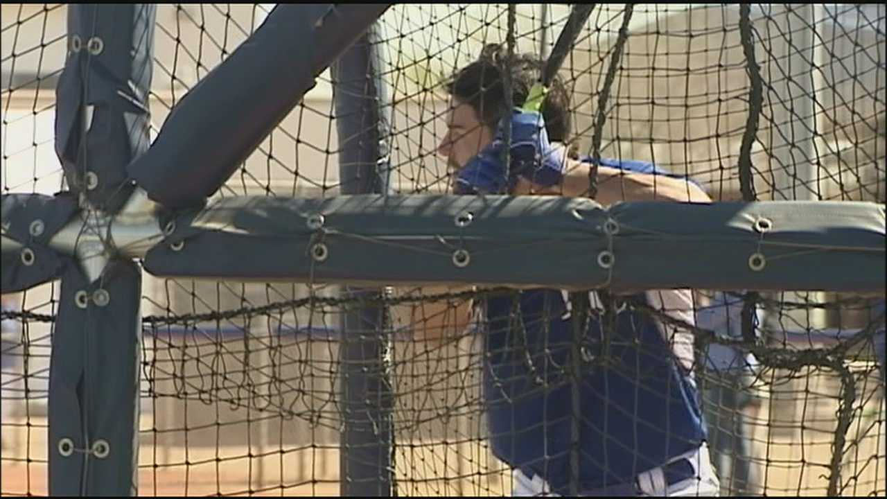 The Royals have begun their first full-squad workouts at spring training, preparing to defend their American League championship.