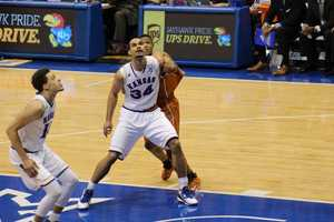 The Kansas Jayhawks hosted the Texas Longhorns Saturday at Allen Fieldhouse. With two minutes remaining in the game, forward Perry Ellis scored on a layup to give the Jayhawks a lead they wouldn't give up. Kansas won 69-64. Ellis scored 28 points and grabbed 13 rebounds in the game.