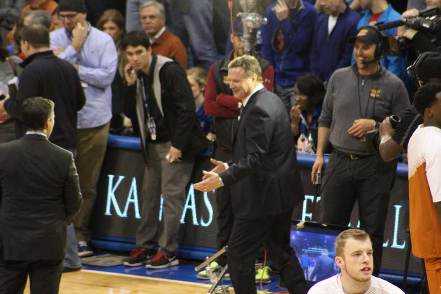 The Kansas Jayhawks hosted the Texas Longhorns Saturday at Allen Fieldhouse. ESPN's College Gameday crew was in the house. Kansas head coach Bill Self smiles as he steps through the pregame show on the court.