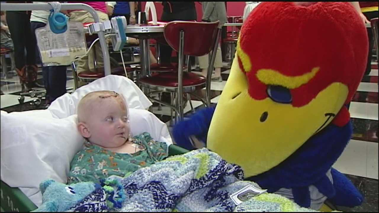 Big 12 mascots and cheerleaders visit Children's Mercy Hospital to spend some time with the young patients.