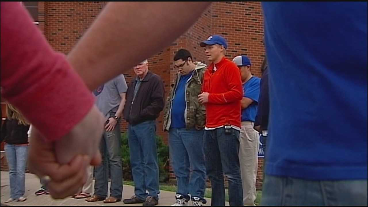 Friends and family members gathered Monday evening to pray for the recovery of a Royals superfan who was shot when he interrupted a burglary at his Independence home.