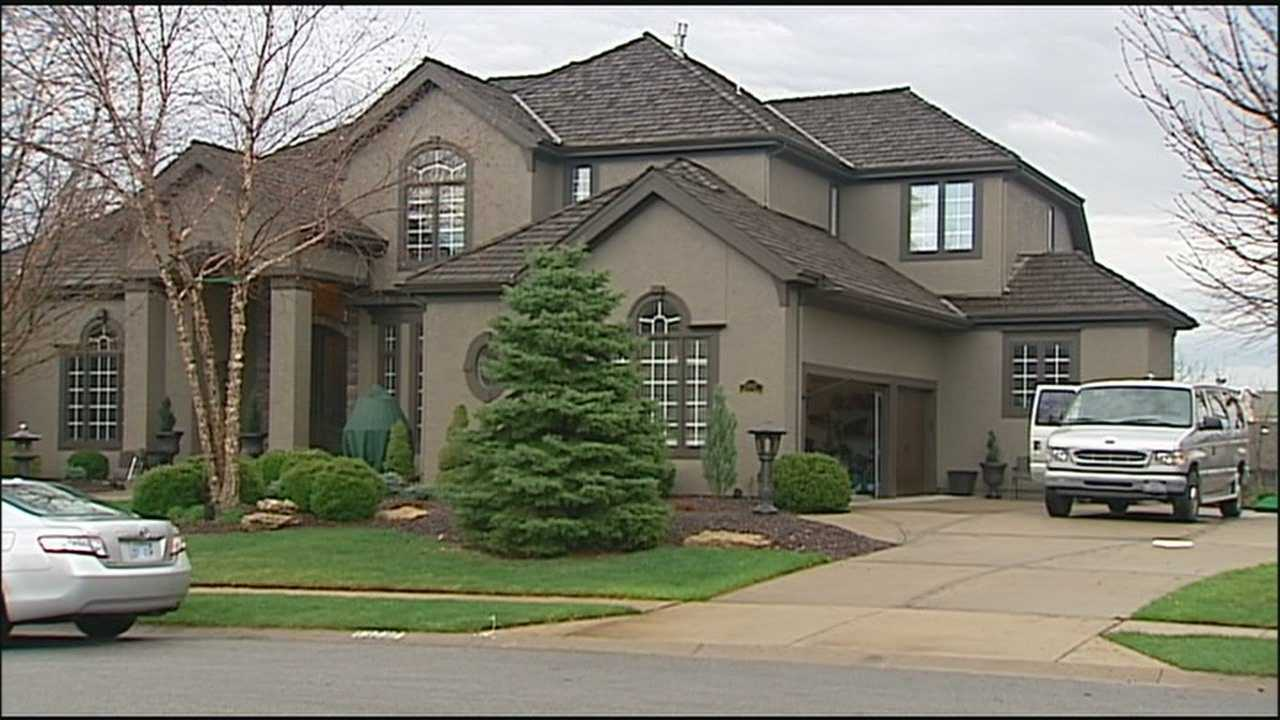 Police spent a second day of searching an Overland Park home after a woman was arrested on suspicion of shoplifting.