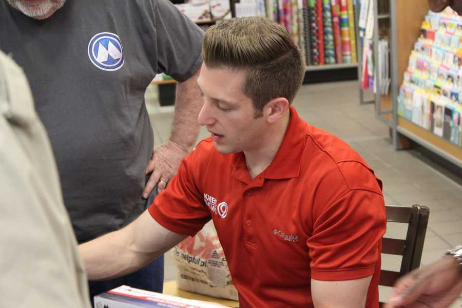 KMBC 9 News meteorologists Nick Bender and Neville Miller help program viewers weather radios during tornado season.
