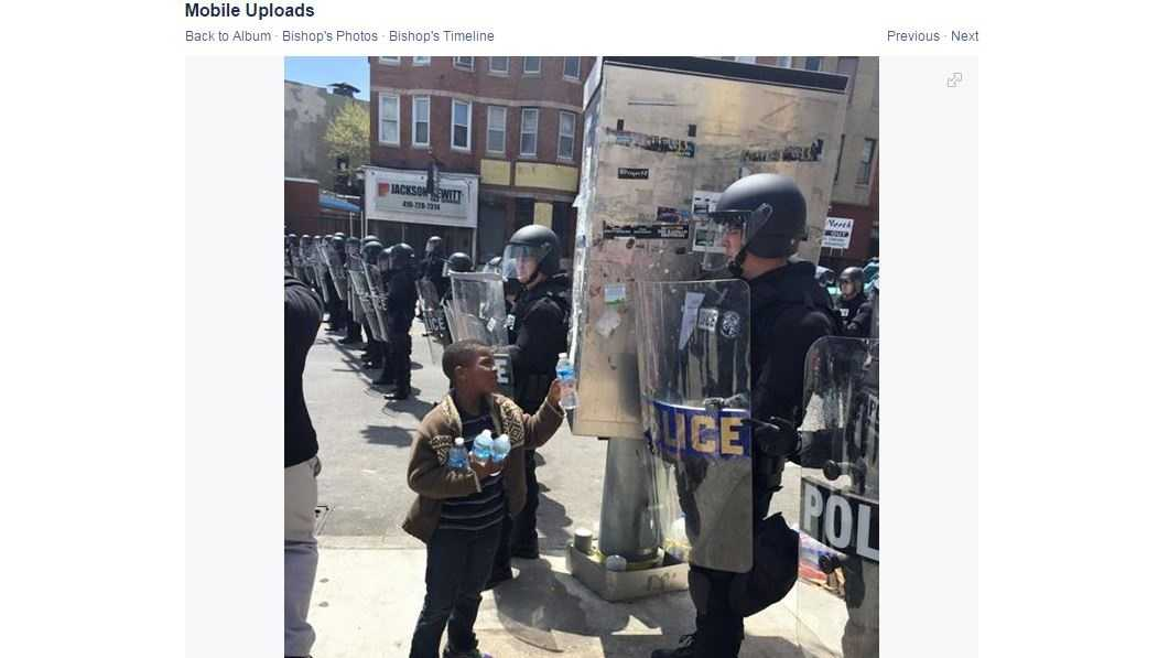 Bishop Martese Cromartie, whose photo of a little boy giving Baltimore police water went viral, will continue the cleanup effort on Wednesday.