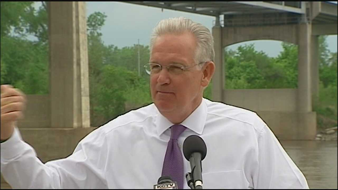 Gov. Jay Nixon came to the site of a Kansas City-area bridge shutdown Thursday to push for an increase in Missouri's fuel taxes.