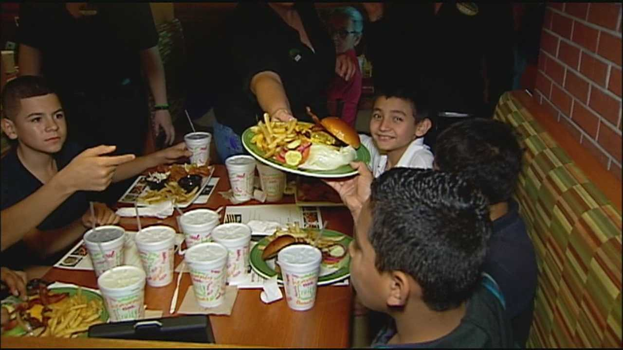 Some Kansas City middle schoolers spent Monday having their first meal at an American restaurant.