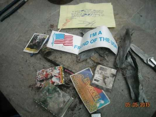 """The time capsule included a few sports cards, including what appears to be a Joe Montana Kansas City Chiefs card. A bumber sticker reading """"I'm a friend of the U.S.A."""" was included in the package."""