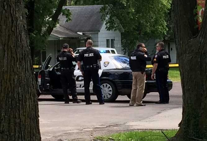 Authorities surround a home in Sedalia in connection with a double homicide in Clinton. Police said they found Sandra Kay Sutton, 46, and her son, Zachary Wade Sutton, 17, dead from gunshot wounds early Thursday morning.