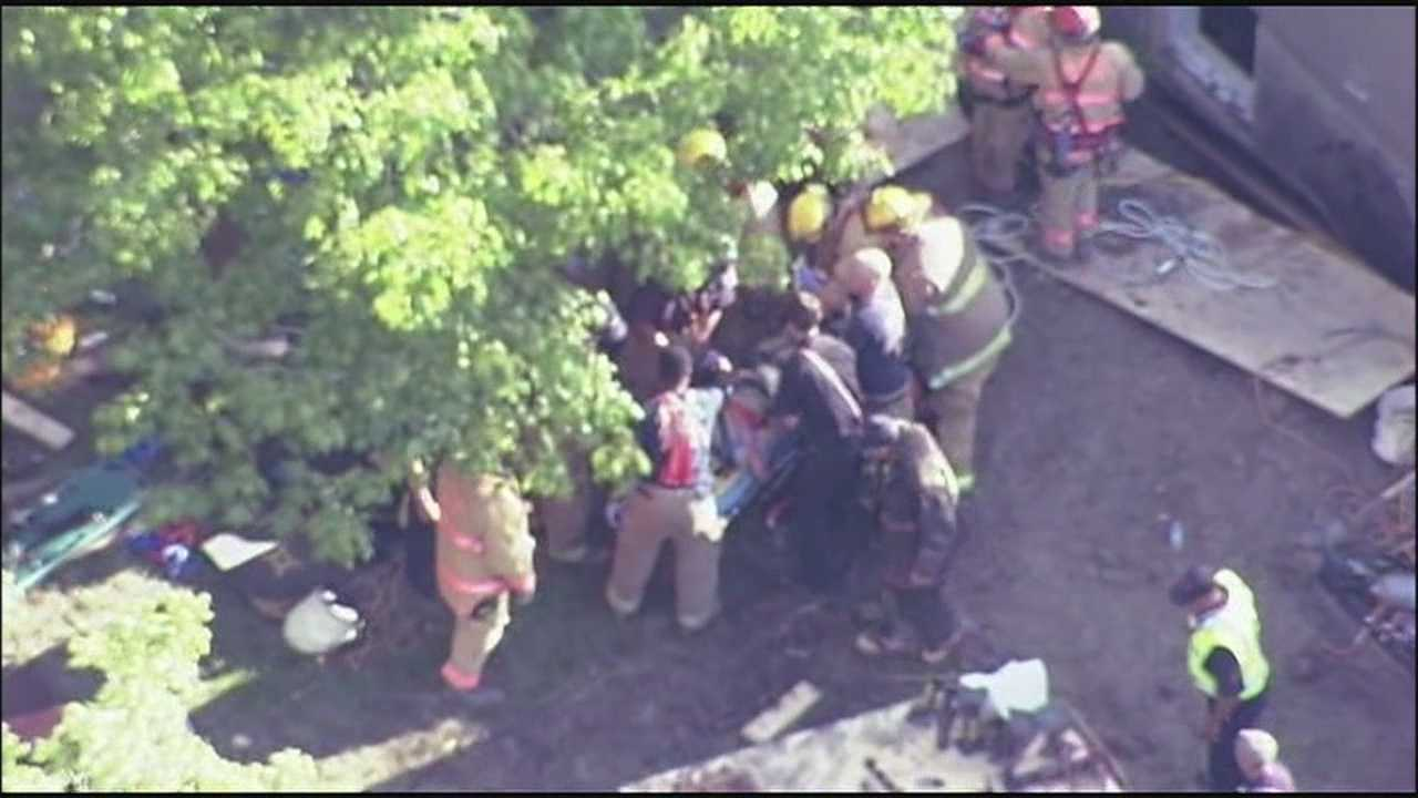 Emergency crews rescued a man trapped in a trench under soil and mud Tuesday afternoon.