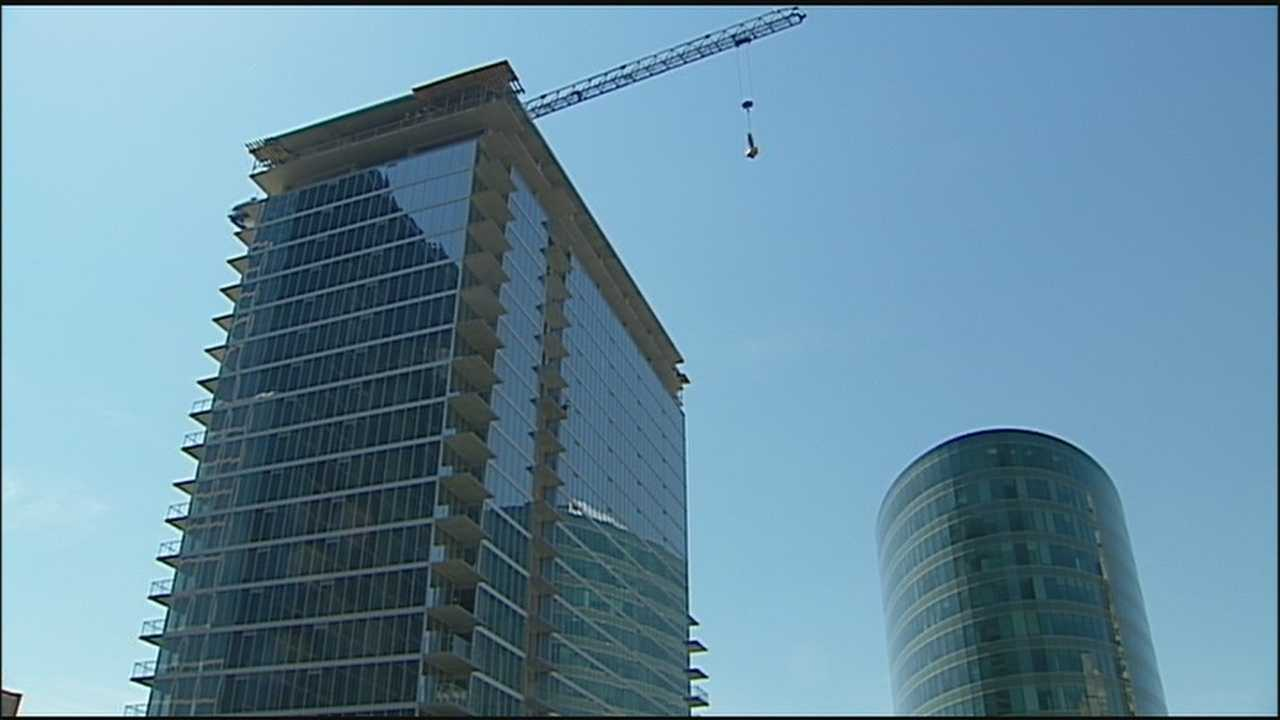 A topping-off ceremony helped construction on a luxury high-rise apartment tower in downtown Kansas City pass a key milestone.