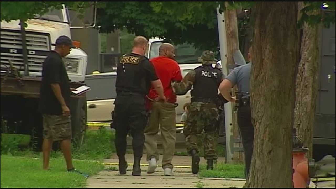 A police standoff at a midtown Kansas City apartment has ended with an arrest and a woman's apartment trashed.
