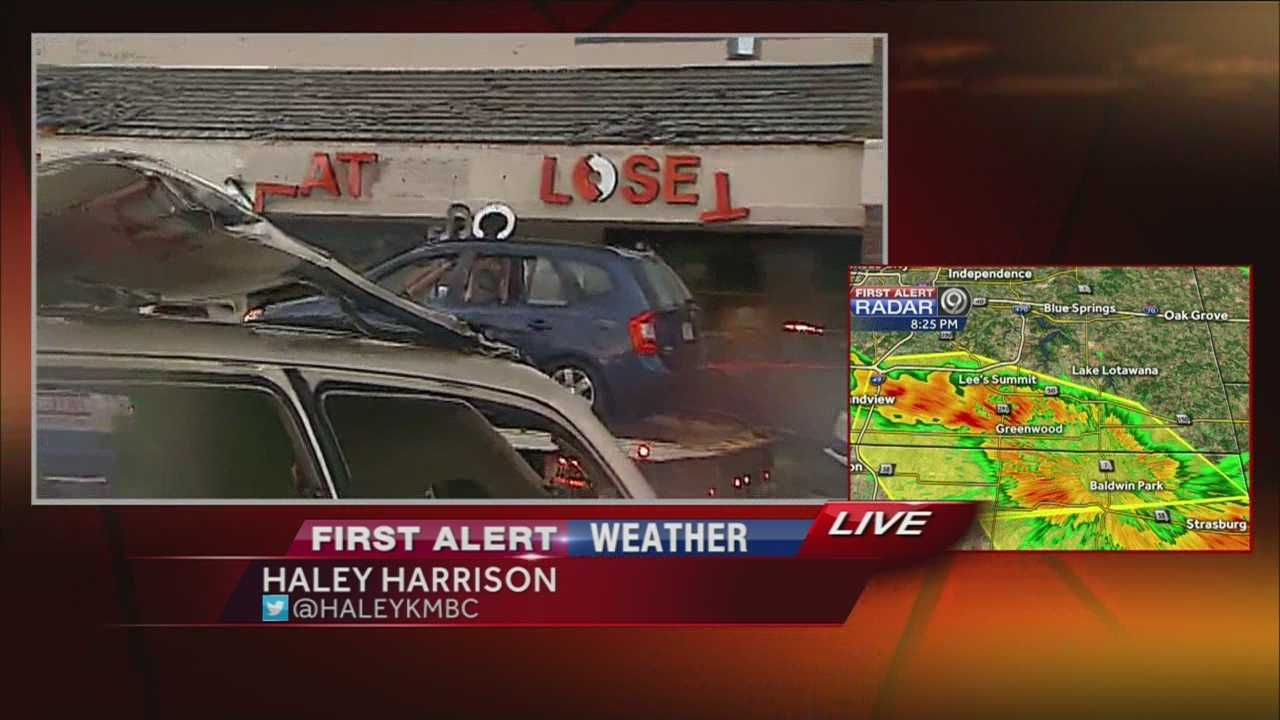 Strong storms caused damage to store fronts off Douglas Street in Lee's Summit, and also moved and damaged some cars parked in the lot.