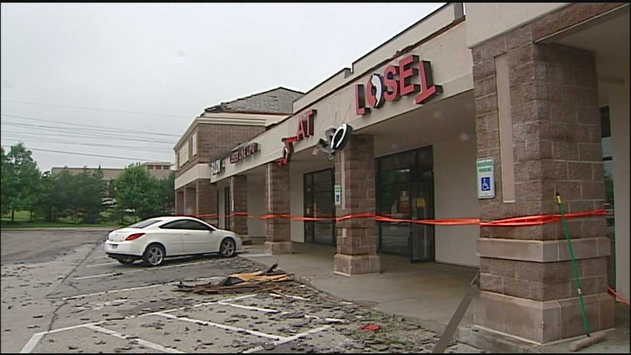 Business owners at a strip mall in Lee's Summit cleaned up damage left behind after an EF-1 tornado struck Wednesday evening.