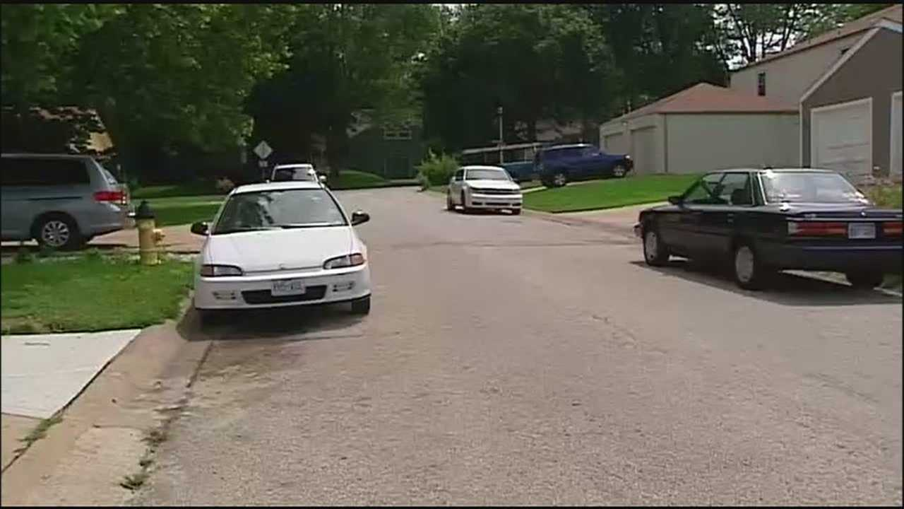 An arrest in the fatal shootings of two young men in an Overland Park neighborhood has helped to ease some tensions, but residents said that the crime spree is keeping them on edge.