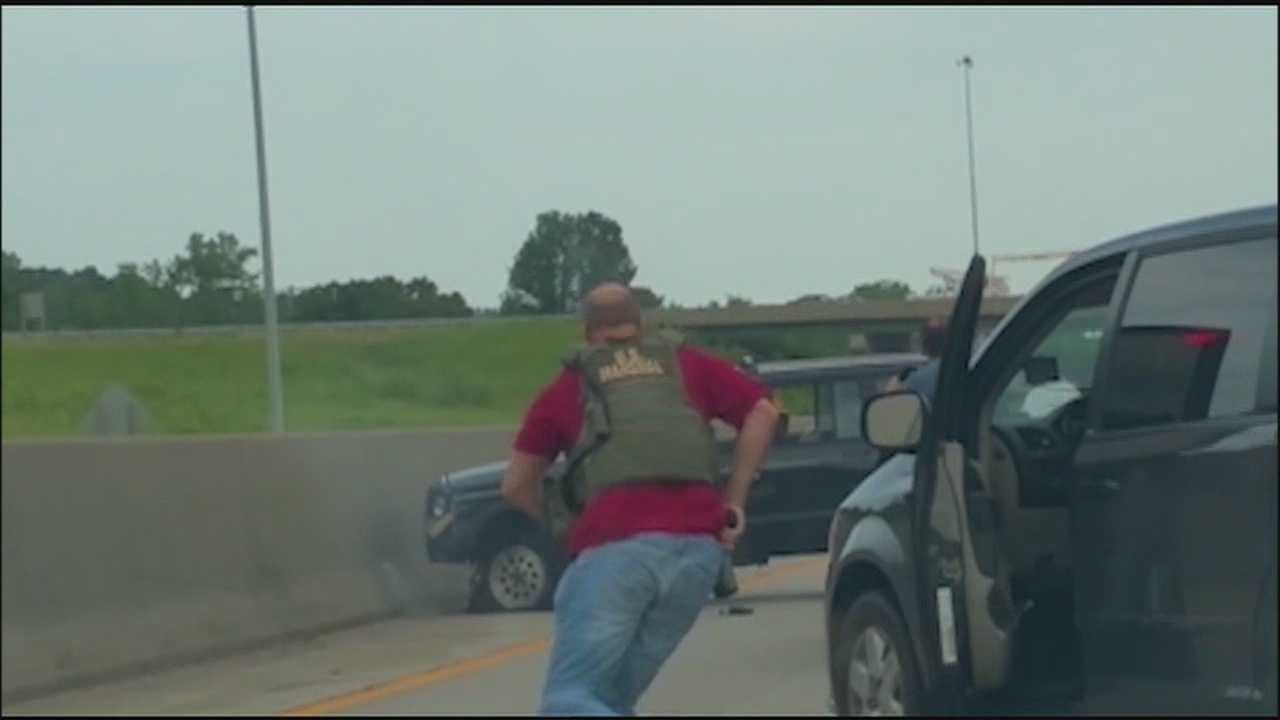 A driver catches dramatic video of the end of a police chase on Interstate 35 and the fatal shooting of a man who had been on the run.