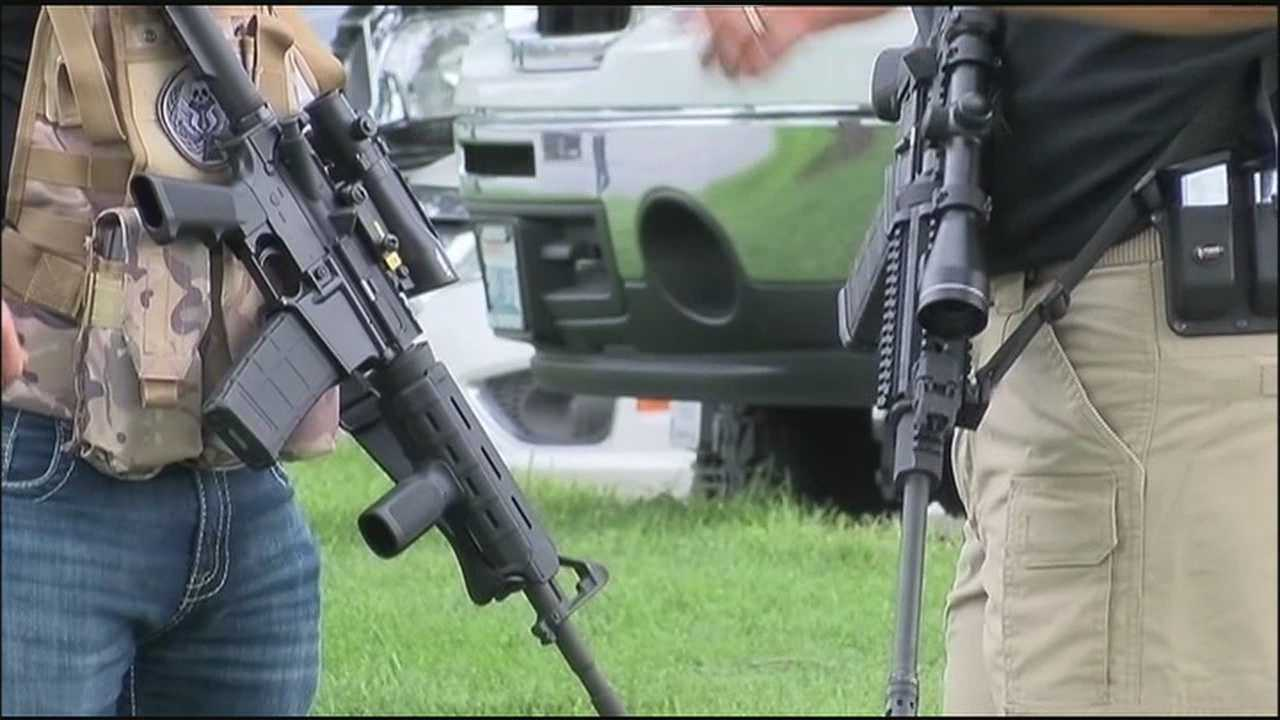 With military security a major concern after the killings at two military offices in Chattanooga, Tennessee last week, two local groups offer armed security outside the Armed Forces Career Center in Lenexa.