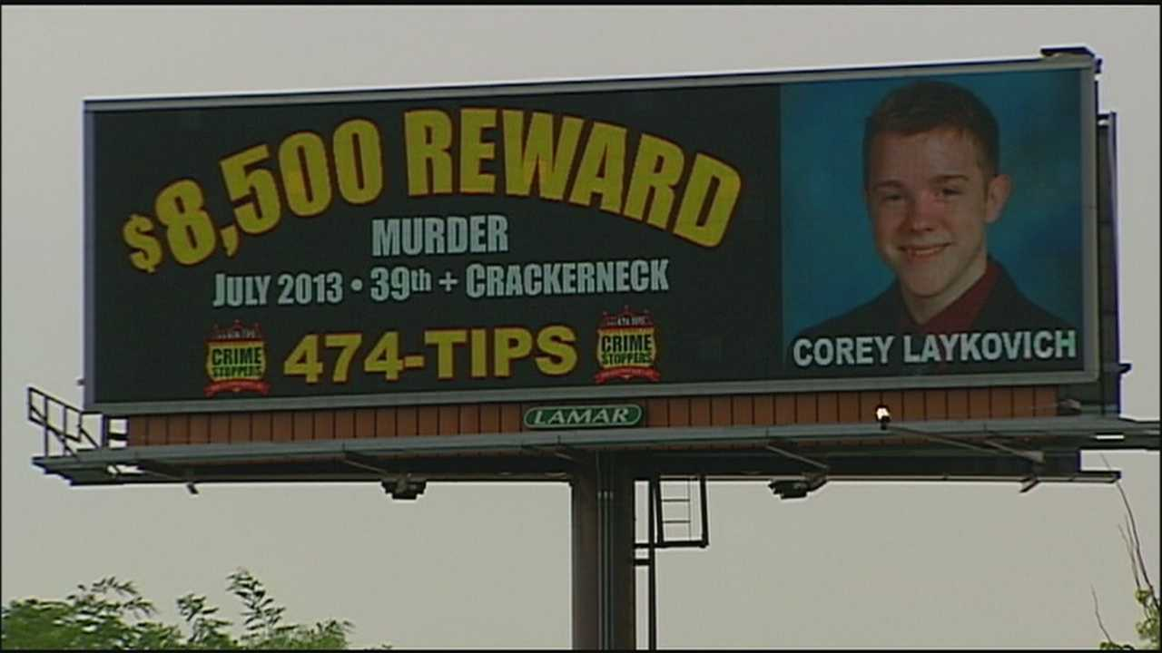 Sandwiched between ads on a busy stretch of Interstate 470 in Lee's Summit is a plea from a mother for information about her son's slaying.