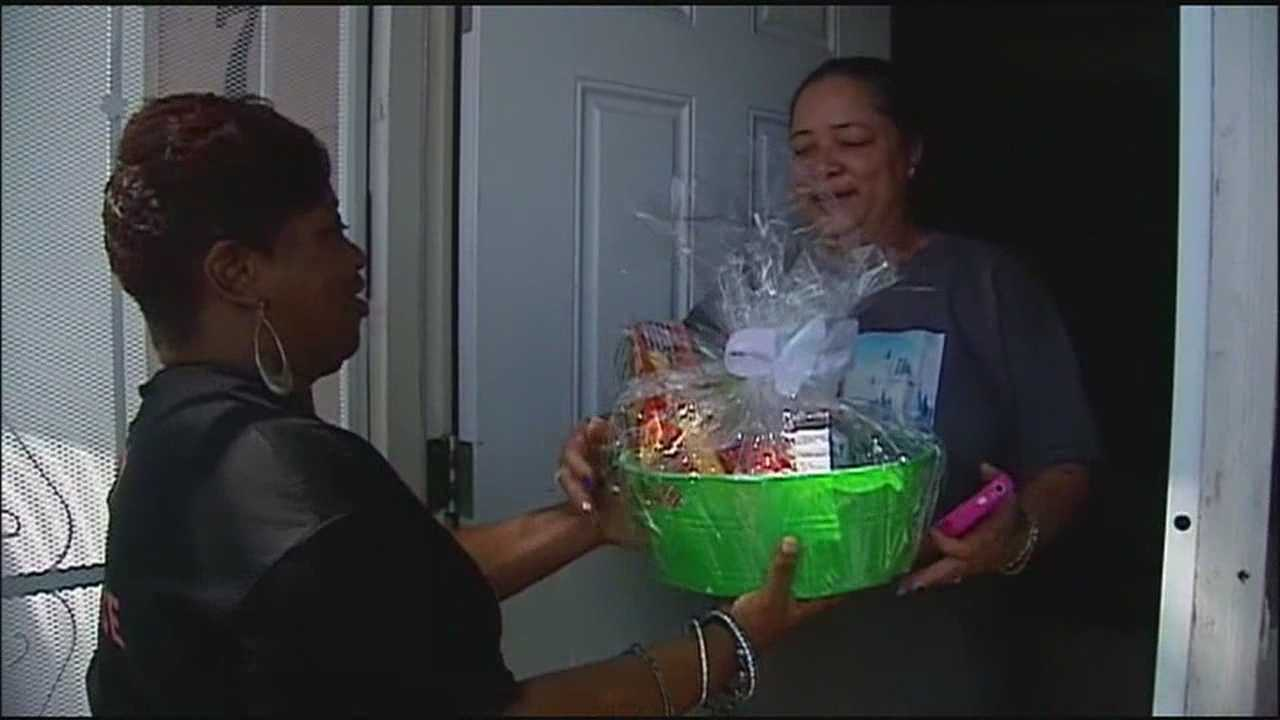 After four homicides in Kansas City over the past week, Kansas City's Mothers in Charge stopped by the homes of some of the victims with a gift and a show of support for the families.