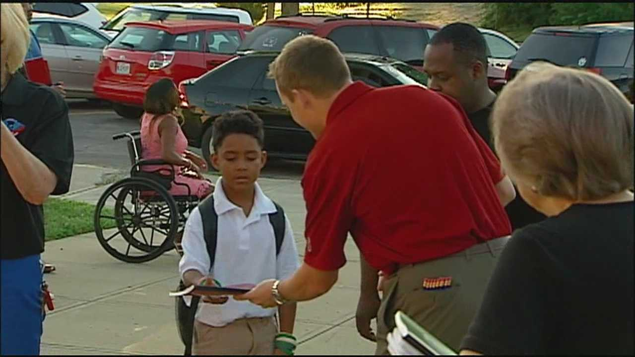 Students, staff given warm welcome on 1st day of school