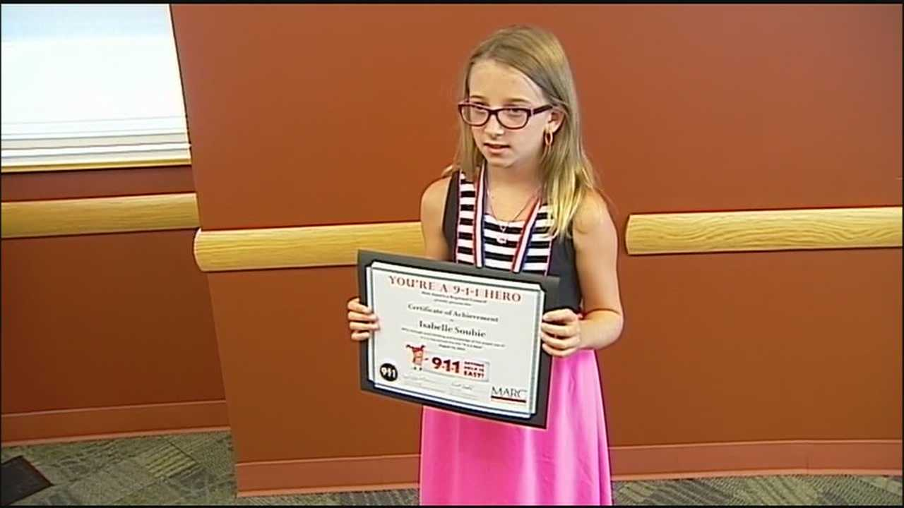 The 9-year-old girl whose 911 call saved her grandfather's life was honored Thursday in Overland Park.