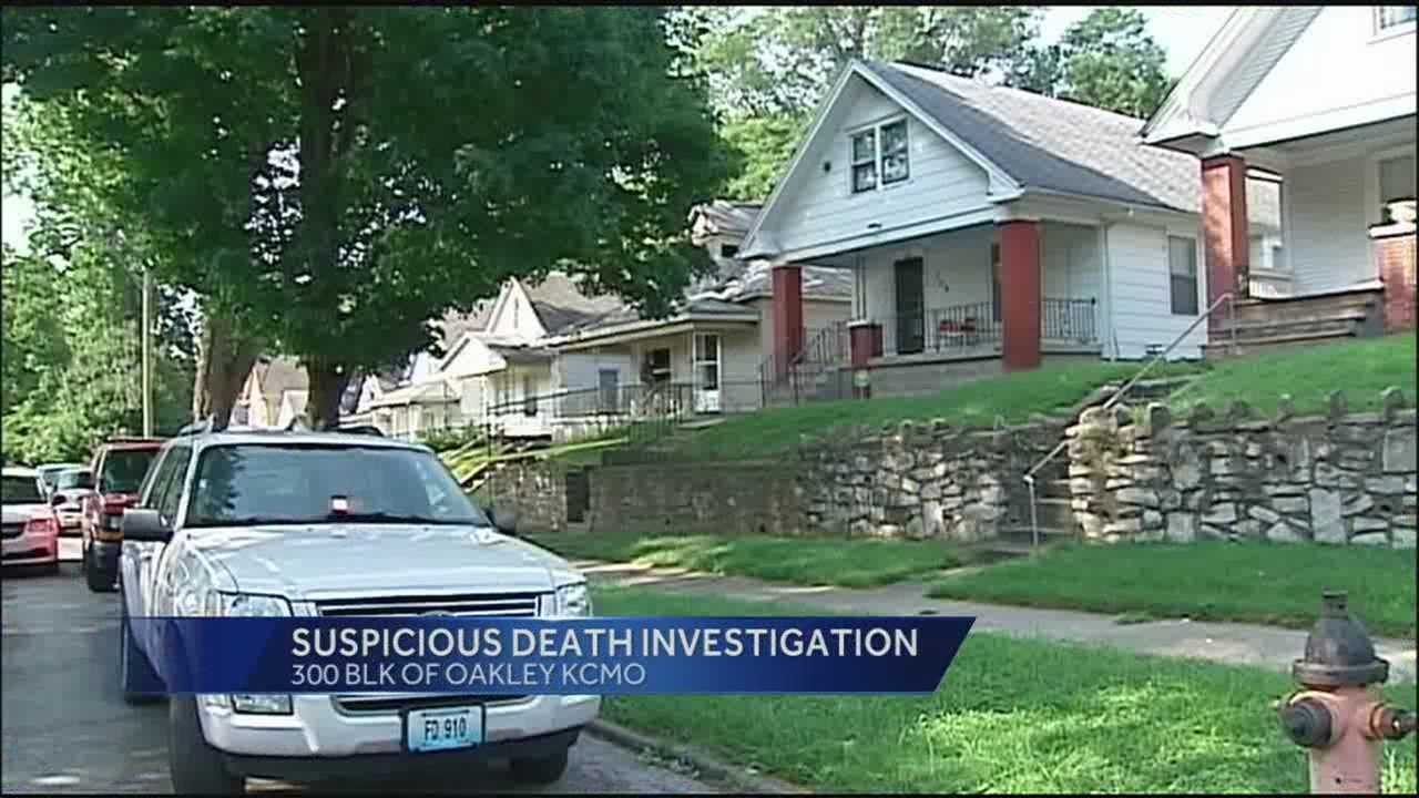 Police said they are investigating the discovery of a man's body inside a burning Kansas City home as a suspicious death.