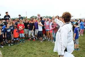 KMBC 9 News sports reporter Karen Kornacki visits with Lee's Summit West students during a pregame live shot.