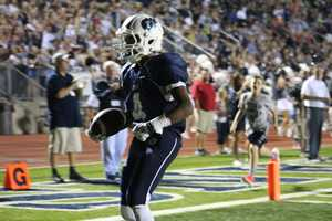Titans running back Phillip Brooks scores yet another one of his touchdowns in the 34-21 Lee's Summit West victory.