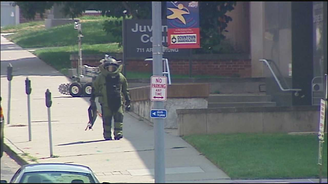 A suitcase found in a tree outside the Wyandotte County Courthouse led to a brief evacuation and a shutdown of a busy street in the area.